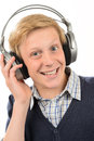 Cheerful Teenage Boy Listening To Music Royalty Free Stock Image - 41020746
