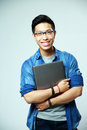 Happy Asian Man Standing With Laptop Royalty Free Stock Photos - 41022138