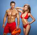 Sexy Smile Couple Rescuers Of Water Stock Image - 41024801