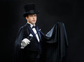 Magician In Top Hat With Magic Wand Showing Trick Stock Photo - 41029730