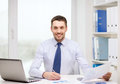 Smiling Businessman With Laptop And Documents Stock Photography - 41033642