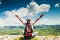 Man Hiker Greeting Rich Nature On The Top Of Mountain Stock Photo - 41057500