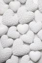 White Hearts Background With Small Roses. Shabby Chic Style. Royalty Free Stock Images - 41076029