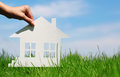 Paper House In Green Grass Over Blue Sky Stock Photography - 41080062