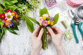 Florist At Work. Woman Making Bouquet Of Wild Flowers Royalty Free Stock Photography - 41106267