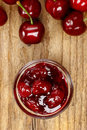 Bowl Of Cherry Jam On Wooden Table And Fresh Cherries Around Stock Photography - 41107062