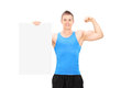 Muscular Man Holding A Banner And Showing Bicep Royalty Free Stock Image - 41114486