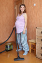 Pregnant Woman Cleans At Home Stock Image - 41130571