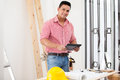 Happy Contractor Using A Tablet Stock Image - 41160041