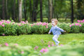 Adorable Curly Baby Girl Running In A Beautiful Park Royalty Free Stock Photos - 41182108