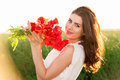 Portrait Of Beautiful Young Woman Holding Poppies Bouquet In The Field Royalty Free Stock Images - 41184859