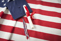 Graduation Cap And Diploma Resting On American Flag Royalty Free Stock Images - 41193749