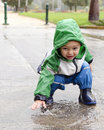 Child Playing In Puddle Royalty Free Stock Image - 41199906