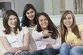 Four Teenage Girls Watching Television Stock Image - 41211131