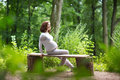 Young Pregnant Woman Relaxing In The Park After An Active Walk Royalty Free Stock Photo - 41227915