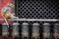 Monkey On Prayer Wheels In Nepal Royalty Free Stock Image - 41231266