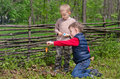 Two Small Boys Lighting A Fire In Woodland Stock Photo - 41236980