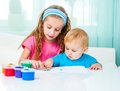 Two Sisters Draw Finger Paints Royalty Free Stock Photos - 41241898