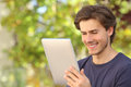 Happy Man Reading A Tablet Reader Outdoors Royalty Free Stock Photo - 41253615