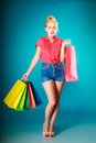Pinup Girl With Shopping Bags Buying Clothes. Sale Stock Photography - 41257882