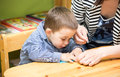 Mother And Child Boy Drawing Together With Color Pencils In Preschool At Table In Kindergarten Stock Image - 41265131