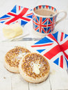 Buttered English Crumpets With Cup Of Tea And Flag In Closeup Stock Photo - 41281200