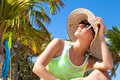 Woman Under Palm Tree At Beach Royalty Free Stock Photo - 41295185