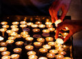 Lighting Candles In A Church Royalty Free Stock Image - 41299336