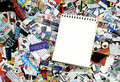 Blank Notepad And Magazine Clippings Royalty Free Stock Images - 4131039