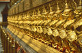 Golden Row Of Buddhist Temple Keepers Royalty Free Stock Images - 4138459