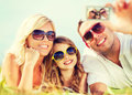 Happy Family With Camera Taking Picture Royalty Free Stock Photo - 41312305