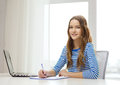 Smiling Teenage Girl Laptop Computer And Notebook Royalty Free Stock Image - 41312526