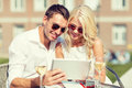 Couple Looking At Tablet Pc In Cafe Stock Photos - 41313743