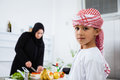 Arabic Child In The Kitchen With His Mother Stock Photos - 41326533