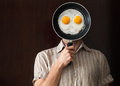 Young Man Portrait Behind Black Pan With Eggs Stock Photos - 41335273