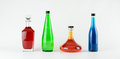Four Colorful Glass Bottles Royalty Free Stock Images - 41346909