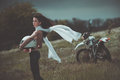 Biker Girl Next To A Motorcycle Royalty Free Stock Photography - 41346927