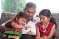 Indian Family Using Tablet Computer. Stock Images - 41350594