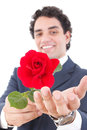 Adult Handsome Smiling Man In A Suit Holding A Red Rose And Offe Stock Photos - 41368713
