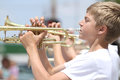 Youth Plays Trumpet In Parade In Small Town America Royalty Free Stock Image - 41383866