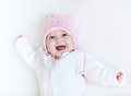 Funny Laughing Baby Girl In White Knitted Sweater Stock Image - 41386701