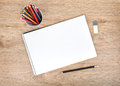 Blank Paper And Colorful Pencils On The Wooden Table Royalty Free Stock Photos - 41386988
