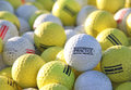 White And Yellow Practice Golf Balls At Golf Course Hitting Range Stock Images - 41397474