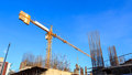 Building Crane And Construction Site Under Blue Sky Royalty Free Stock Image - 41399616