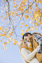 Low Angle View Of Couple Hugging Against Autumn Tree Stock Images - 41407244