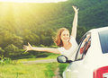 Happy Woman Looks Out The Car Window On Nature Royalty Free Stock Photography - 41408707