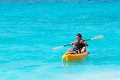 Father And Son On A Kayak Ride In A Tropical Sea Royalty Free Stock Image - 41454766