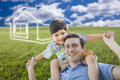 Father And Son Over Grass Field, Sky, Ghosted House Icon Royalty Free Stock Photography - 41463187