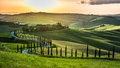 Sunset Over The Winding Road With Cypresses In Tuscany Royalty Free Stock Photography - 41492247