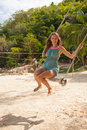 Girl Playing The Swing On Beach Stock Images - 41498404
